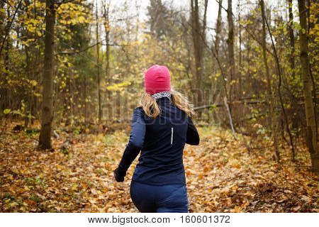 Woman in pink hat jogging