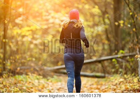 Beautiful sportswoman running in morning