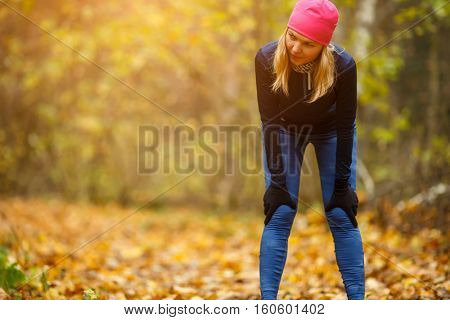 Sportswoman in hat at park