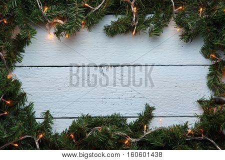 Spruce branches on wooden background