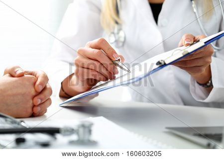 Female Doctor Hand Hold Silver Pen Filling Patient History List
