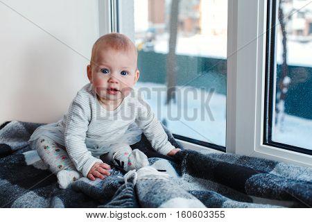 Child On A Window