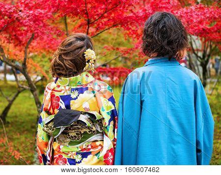 Couple With Yukata And Kimono Enjoy Autumn Colors