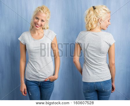 Woman in grey round neck T-shirt on blue background