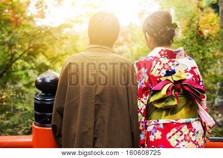 Couple With Yukata And Kimono Enjoy Autumn