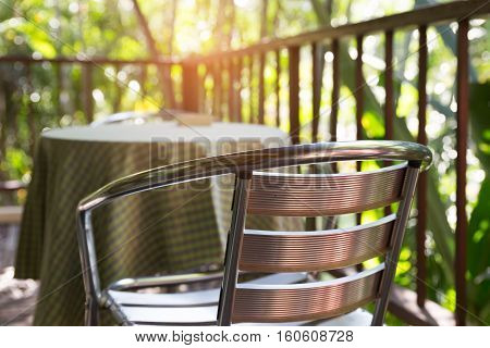 Metal Chair On Terrace Balcony Near Garden