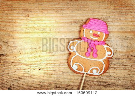 Christmas gingerbread man on old wooden background