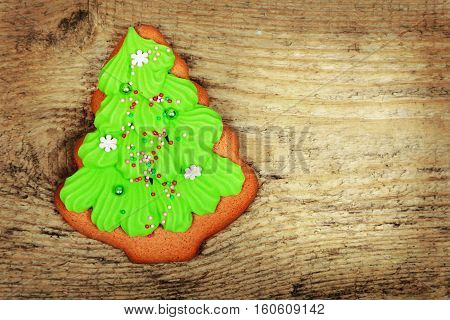 Gingerbread Christmas tree on old wooden background