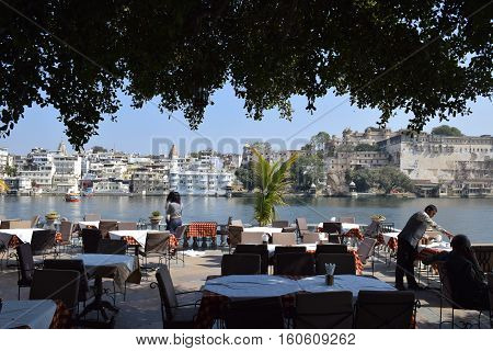 UDAIPUR, RAJASTHAN, INDIA, FEBRUARY 07, 2016 - Amazing view of Udaipur and lake Pichola from a terrace of a restaurant