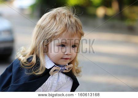 Little Boy Child In Mantle Outdoor