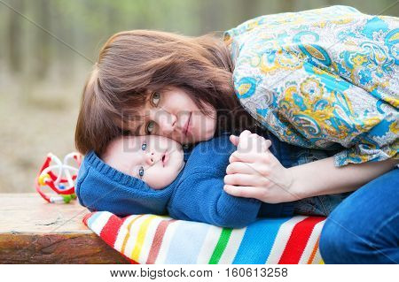Young Mother Hugging Her 4 Month Old Son