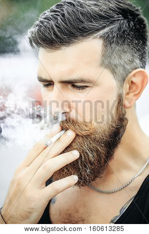 Frown Bearded Man Smoking Cigarette