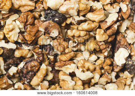 Background from a lot of fresh cracked walnuts.