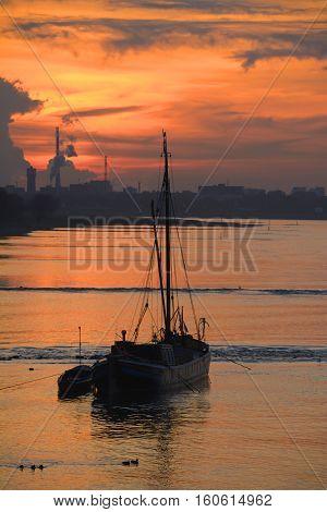 Evening in Rhineland at Rhine River with historic Eel Fishing Boat near Duesseldorf,North Rhine Westphalia,Germany