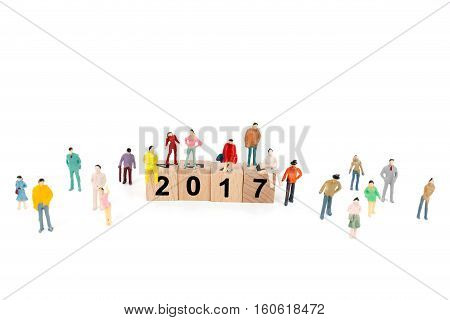 Crowd Of People With Wooden Block Word 2017  On White Background.