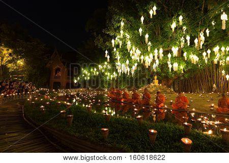 CHIANG MAI, THAILAND - NOVEMBER 14: buddhist monk pray at buddha statue in Yeepeng festival at Puntao temple in Chiang Mai Thailand on November 14 2016.