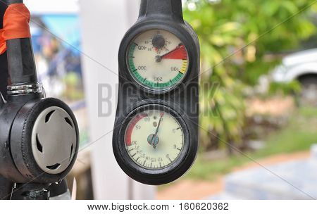 Selective focus on gauge and mouth piece of the regulator, SCUBA diving equipment