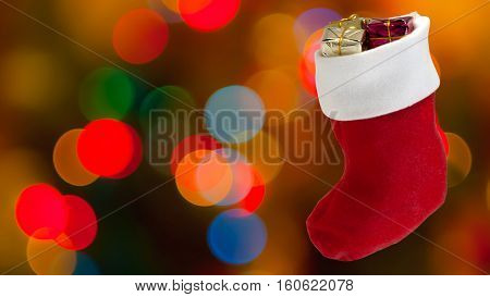 Defocused bokeh lights and boot gifts blur