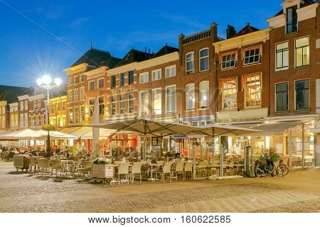 The central market square in the city Delft on sunset. Netherlands.