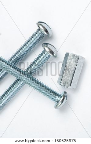 metric screws close-up on white background. spare parts