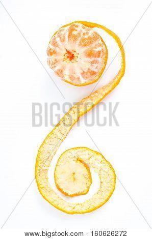 Peeled fresh tangerine or mandarin with peel on white background