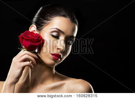 Romantic Woman Holding Red Rose On Black Background