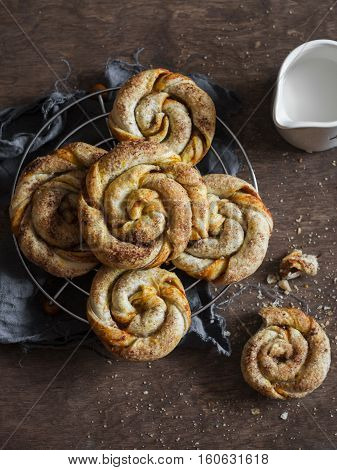 Pumpkin cinnamon puff pastry swirls rolls on a wooden table top view