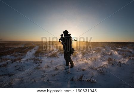 Military Man In A Snow-covered Field