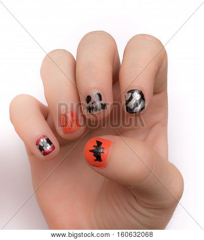 Young lady's fingernails painted artistically with Halloween icons and symbols isolated on white