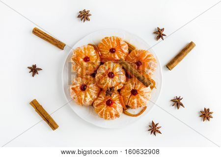Christmas decoration peeled whole tangerine in caramel with citron burning candle white table bright garland.