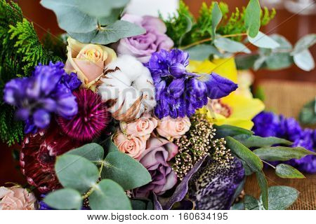 Close up of wedding bouquet eucalyptus cotton and other violet pink green flowers.