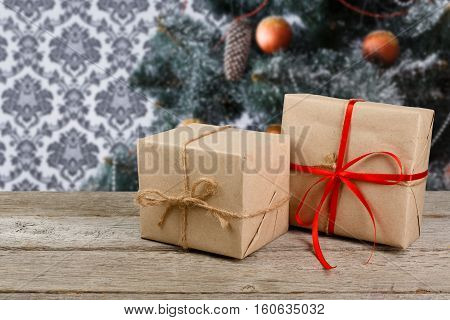 Craft christmas presents on white wood, winter holiday background. Parcel mail delivery concept