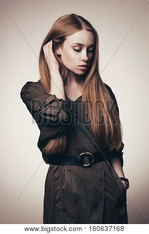 closeup vogue style shot of beautiful female model on gradient studio background