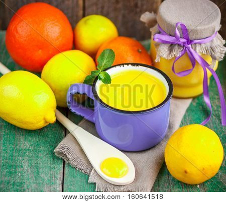 Lemon Custard And Fresh Lemons, Oranges And Mint On Old Wooden Table. Kurd. A Rustic Style. Selectiv