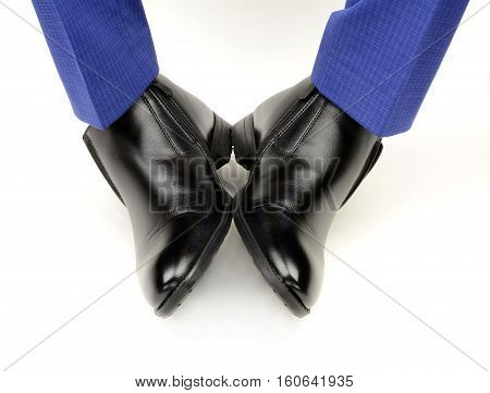 black shoes on the feet of a man on a white background