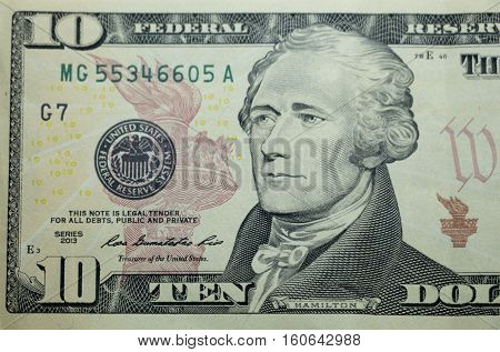 Ten dollar bill (10 usd) closeup macro Alexander Hamilton portrait united states money close up 2013 series
