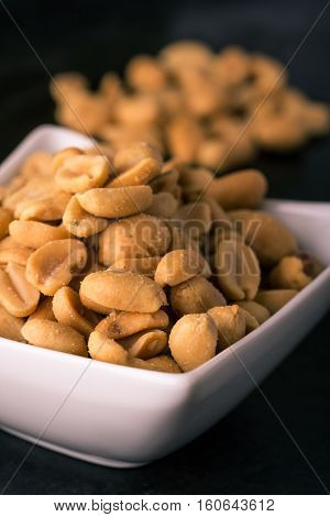 Detail Of Salted Peanuts In White Bowl