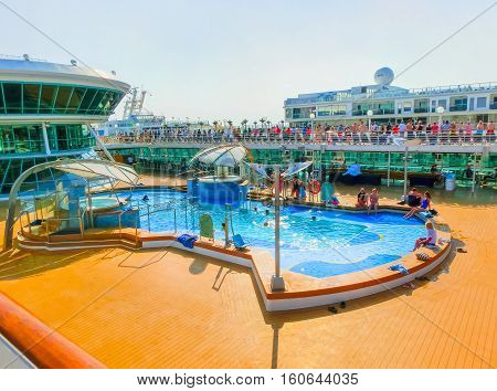 Venice Italy - June 06 2015: Cruise ship Splendour of the Seas of Royal Caribbean International moored in Venice Italy on 06 2015 against another cuise ship Norwegian Jade