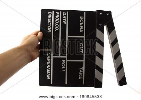 Movie clapper with his hand on a white background