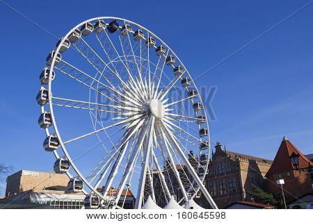 GDANSK, POLAND - DECEMBER 4, 2016: Ferris wheel on traditional winter Christmas market