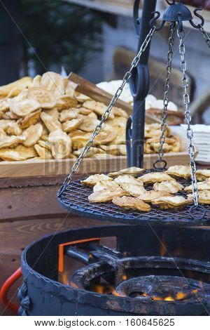 Traditional polish smoked cheese oscypek grilled on Christmas market in Gdansk, Poland