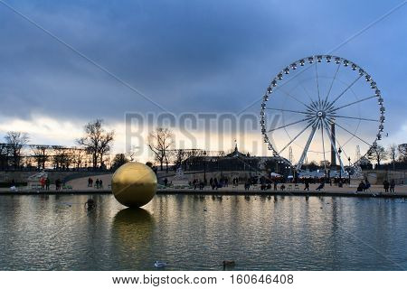 Paris France - January 11 2014: La Grande Roue Ferris wheel and a golden sphere in Paris. Big observation wheel panoramic view