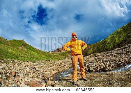 man hiker in the Islandic mountains. Trek in National Park Landmannalaugar, Iceland. man smiling and posing