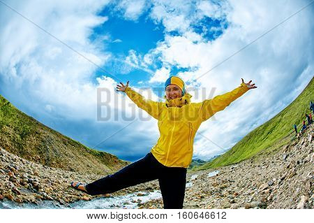 happy woman hiker in the Islandic mountains. Trek in National Park Landmannalaugar, Iceland. woman smiling and posing