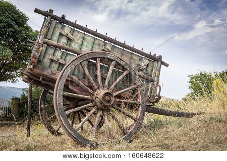 an old wooden chariot in the countryside