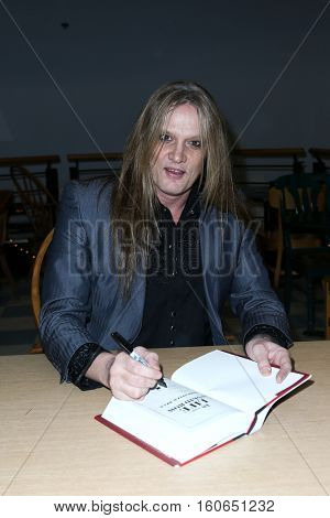 HUNTINGTON, NY-DEC 5: Singer Sebastian Bach signs copies of his book