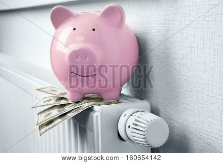 Heating battery with piggy bank on it