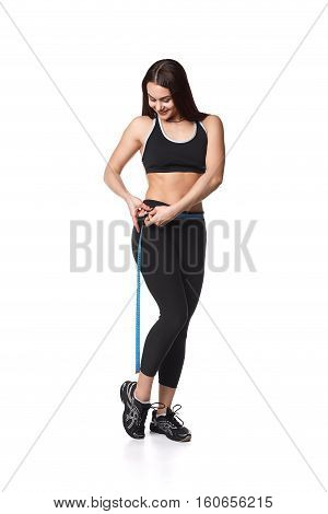 Athletic fitness woman helthy sport isolated white background young female health muscles copy space black clothes smilling attractive beautyful stretch activity