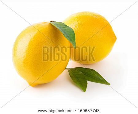 Fresh delicious whole lemons with leaves isolated on white background with soft shadow
