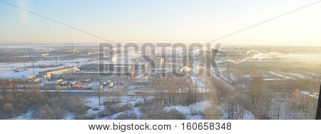 Frosty early sunny winter morning in a little town Pskov in Russia. Made from hight.